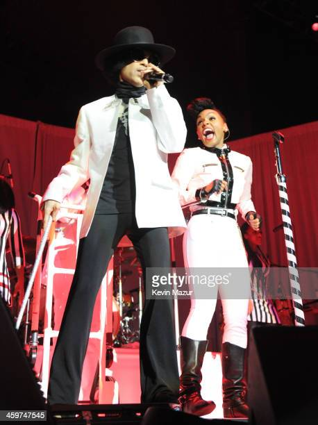 Prince performs with Janelle Monae at Mohegan Sun Arena on December 29 2013 in Uncasville Connecticut