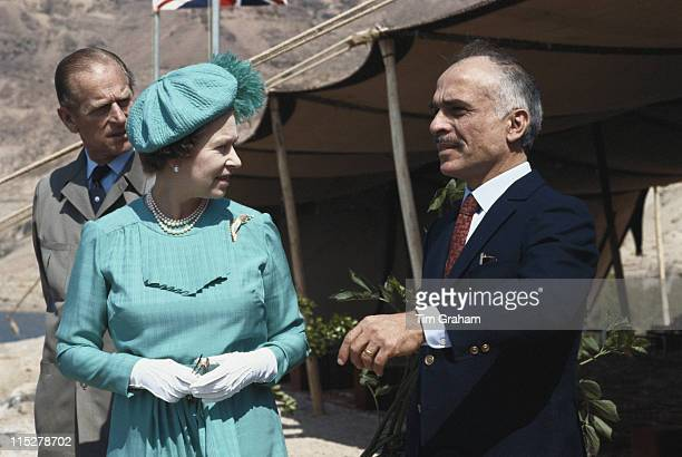 Prince Philip and Queen Elizabeth II with Hussein bin Talal King of Jordan by the Dead Sea during a fiveday state visit to Jordan in 28 March 1984...