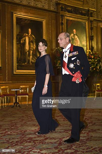 Prince Philip Duke of Edinburgh accompanies President Sarkozy's wife Carla BruniSarkozy to a state banquet at Windsor Castle on the first day of her...