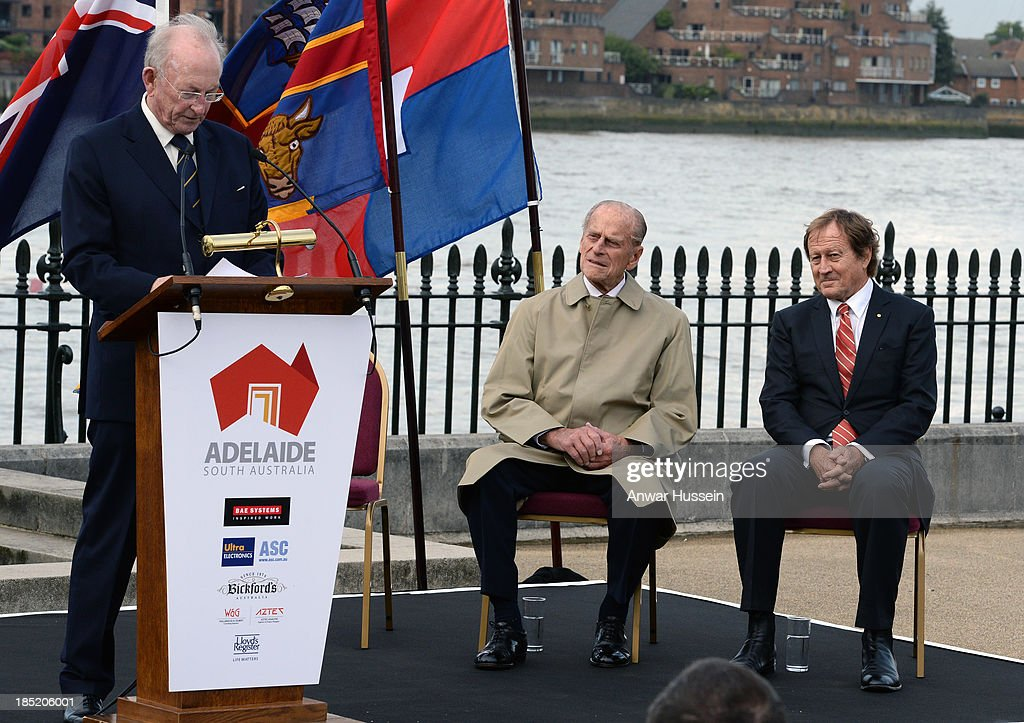 Prince Philip, Duke of Edinburgh and Bill Muirhead (R), Agent General of South Australia, listen to a speech given by Creagh O'Connor at the renaming ceremony for the clipper ship 'The City of Adelaide' on October 18, 2013 in London, England.