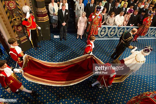 Prince Philip Duke of Edinburgh and Queen Elizabeth II arrive for the state opening of Parliament at the House of Lords on May 8 2013 in London...