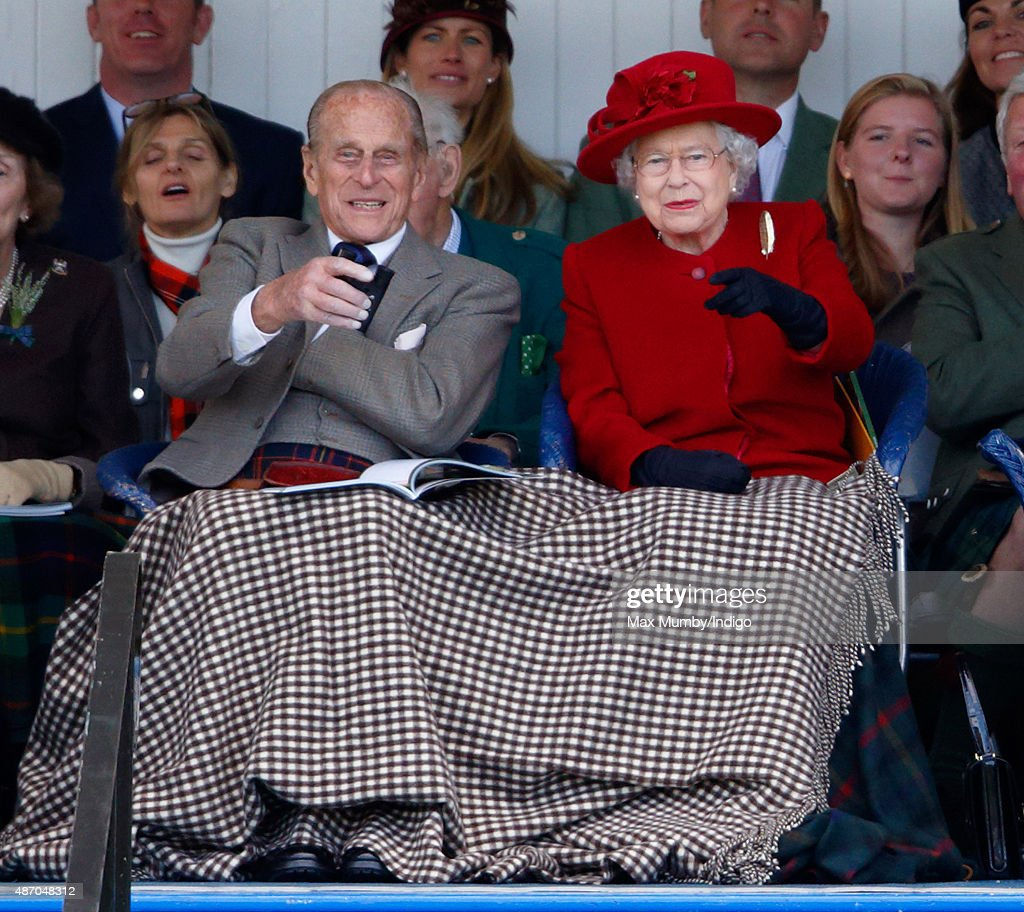 <a gi-track='captionPersonalityLinkClicked' href=/galleries/search?phrase=Prince+Philip&family=editorial&specificpeople=92394 ng-click='$event.stopPropagation()'>Prince Philip</a>, Duke of Edinburgh and Queen <a gi-track='captionPersonalityLinkClicked' href=/galleries/search?phrase=Elizabeth+II&family=editorial&specificpeople=67226 ng-click='$event.stopPropagation()'>Elizabeth II</a> attend the Braemar Gathering at The Princess Royal and Duke of Fife Memorial Park on September 5, 2015 in Braemar, Scotland. There has been an annual gathering at Braemar, in the heart of the Cairngorms National Park, for over 900 years. The current gathering, in the form of a Highland Games and run by the Braemar Royal Highland Society (BRHS), takes place on the first Saturday in September and sees competitors in Running, Heavy Weights, Solo Piping, Light Field and Solo Dance watched by around 16000 spectators. This year the BRHS commemorate their bi-centenary. Members of the Royal family often attend the event and Her Majesty the Queen is Chieftain of the Braemar Gathering.