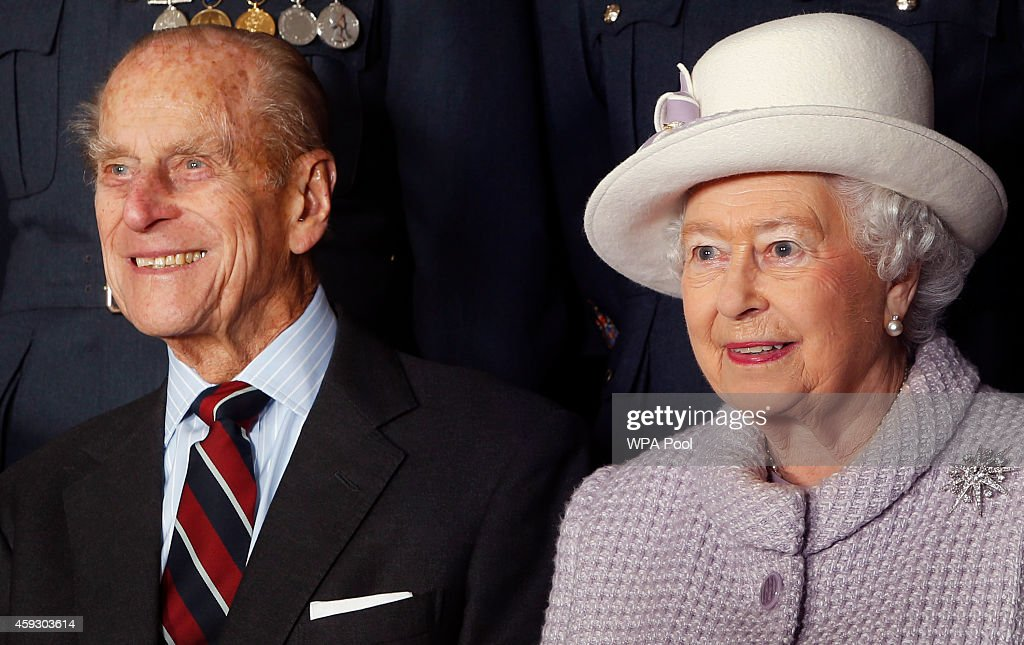 Prince Philip Duke of Edinburgh and Queen Elizabeth II pose for a photo during a visit to RAF Lossiemouth on their 67th wedding anniversary on...