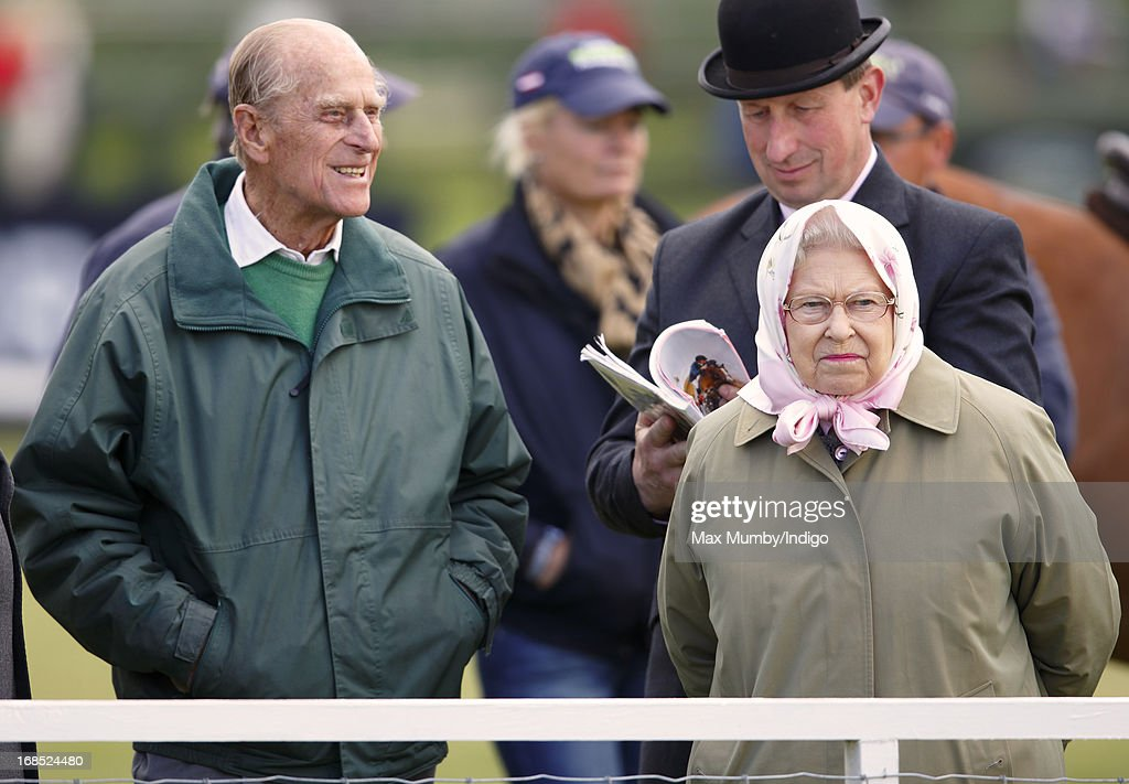 Prince Philip, Duke of Edinburgh and Queen Elizabeth II watch her horse Barbers Shop win the Tattersalls & Ror Thoroughbred Ridden Show Horse Class on day 3 of the Royal Windsor Horse Show on May 10, 2013 in Windsor, England.