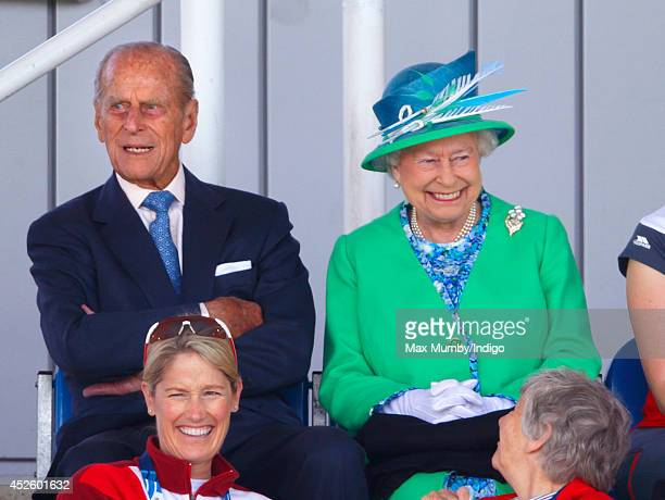 Prince Philip Duke of Edinburgh and Queen Elizabeth II watch the England vs Wales women's hockey match at the Glasgow National Hockey Centre during...