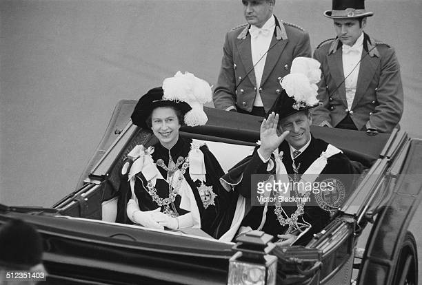 Prince Philip Duke of Edinburgh and Queen Elizabeth II wave to crowds during the Garter Procession at Windsor Castle 1969