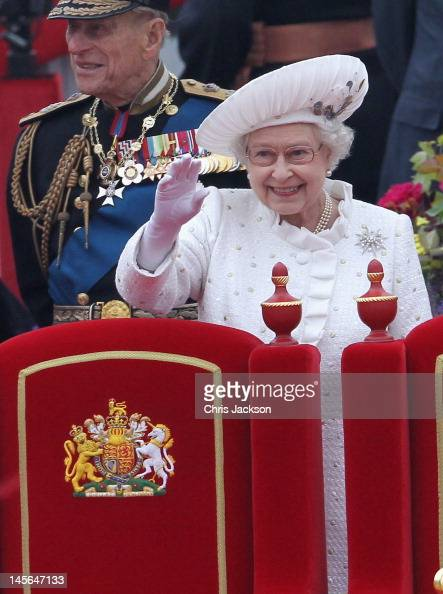 Prince Philip Duke of Edinburgh and Queen Elizabeth II waves from the Spirit of Chartwell during the Diamond Jubilee Thames River Pageant on June 3...