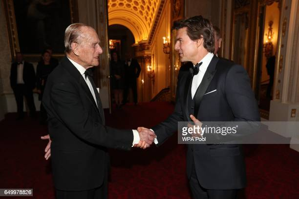 Prince Philip Duke of Edinburgh and Tom Cruise meet during a dinner to mark the 75th anniversary of the Outward Bound Trust at Buckingham Palace on...