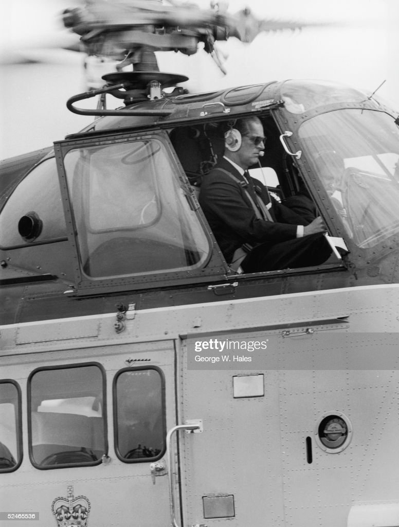 Prince Philip, Duke of Edinburgh at the controls of the royal helicopter, 28th July 1965.