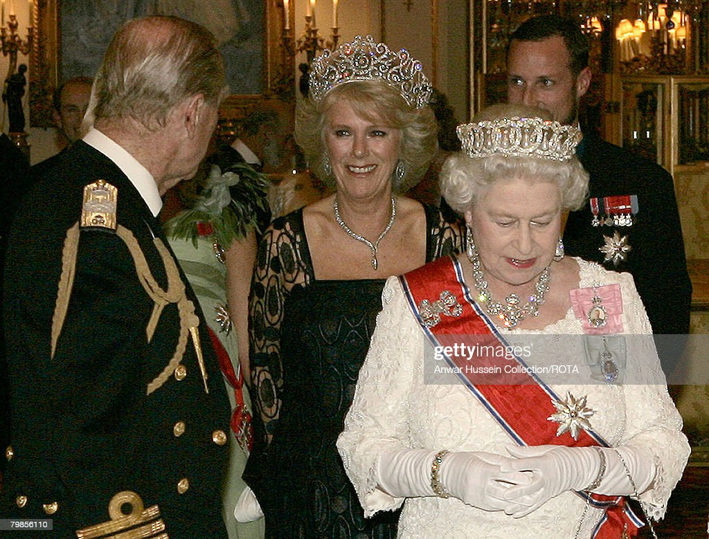 Prince Philip, Duke of Edinburgh, Camilla, Duchess of Cornwall and Queen Elizabeth ll pose before the banquet for the Norwegian Royal Family at Buckingham Palace on October 25, 2005 in London, England. The visit is to mark 100 years of Norway's independence from Sweden.