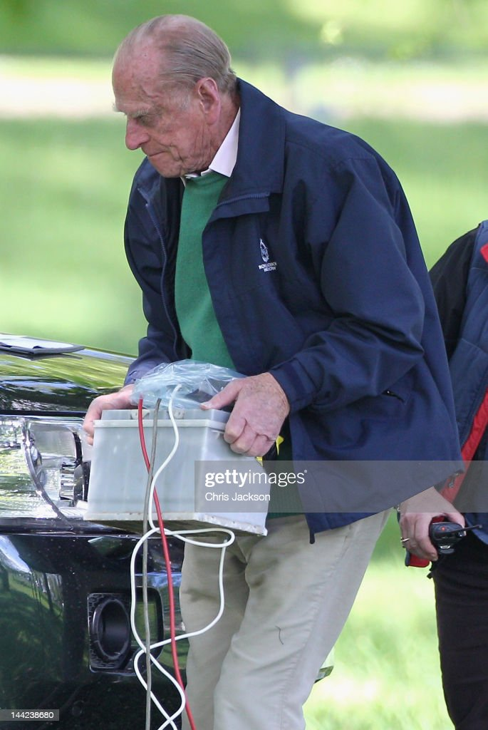 Prince Philip Duke Of Edinburgh Carries A Car Battery Used For Timing Carriage Driving As