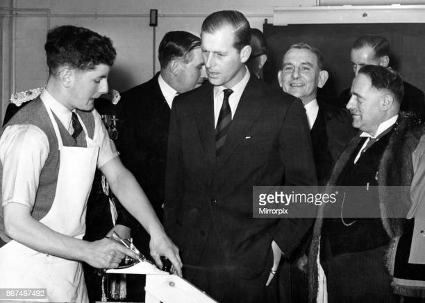 Prince Philip Duke of Edinburgh chats to a carpentry student Brian Locke at at Llandaff Technical College Also on the picture are Mr RE Presswood...