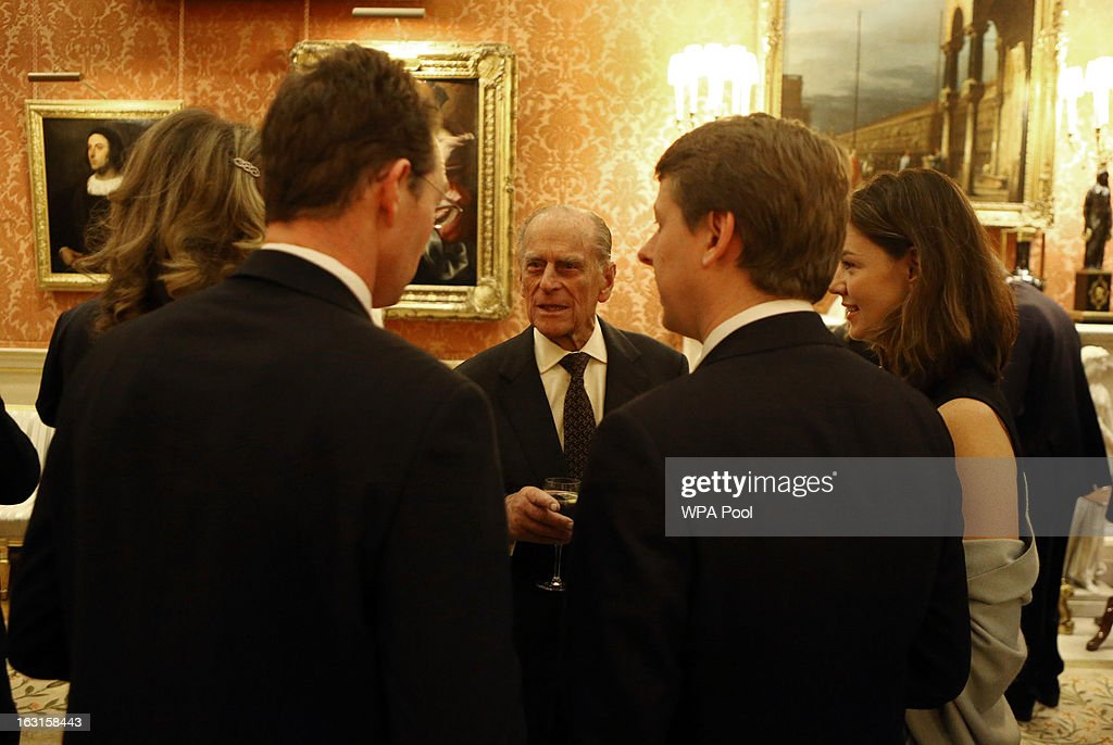 Prince Philip, Duke Of Edinburgh (C) chats to guests during a reception for MPs and MEPs at Buckingham Palace on March 5, 2013 in London, England. The reception was attended by Prince Philip, Duke Of Edinburgh and Sophie, Countess of Wessex.