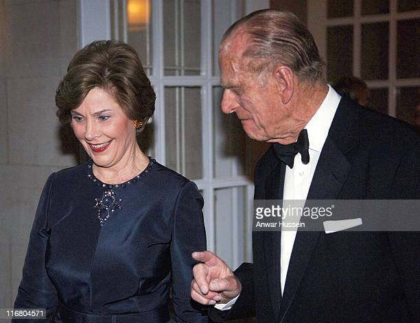 Prince Philip Duke of Edinburgh chats to Laura Bush at a dinner hosted by the Queen at the British Ambassador's Residence in Washington DC on May 8...