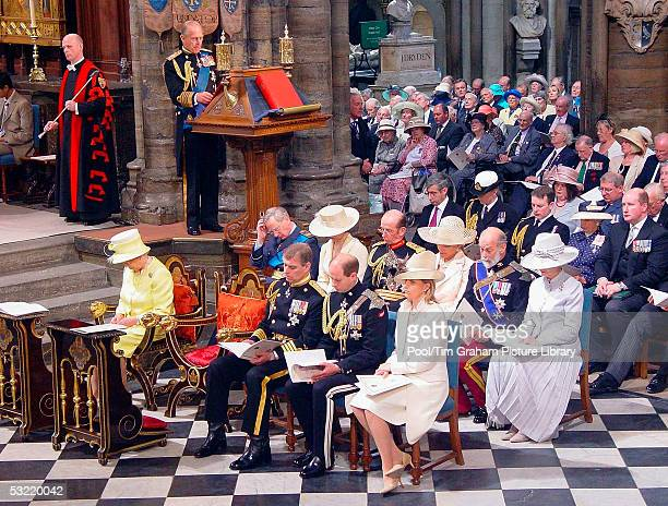 Prince Philip Duke of Edinburgh gives a reading from the Bible as along with Queen Elizabeth II Prince Andrew the Duke of York the Earl and Countess...