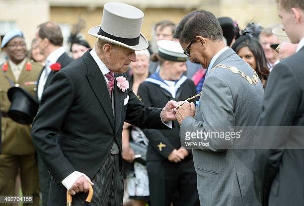 Prince Philip Duke of Edinburgh greets guests at the first garden party of the season in the grounds of Buckingham Palace on May 21 2014 in London...