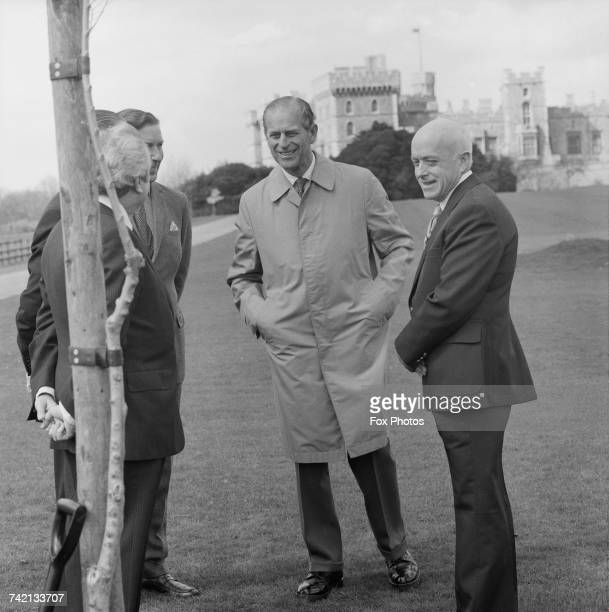 Prince Philip Duke of Edinburgh in Windsor Great Park where he has planted an elm tree resistant to dutch elm disease 8th April 1980 With him are...