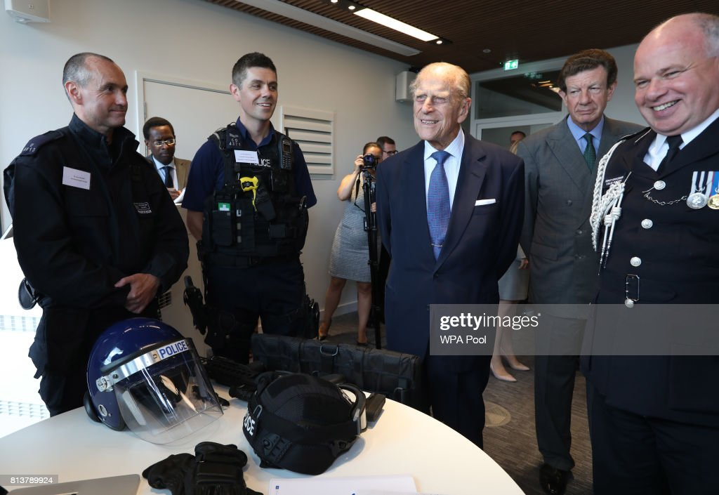 Prince Philip, Duke of Edinburgh is accompanied by Deputy Commissioner of the Metropolitan Police Craig Mackey as he is shown police equipment during the opening of the the new headquaters of the Metropolitan Police Service on July 13, 2017 in London, England.