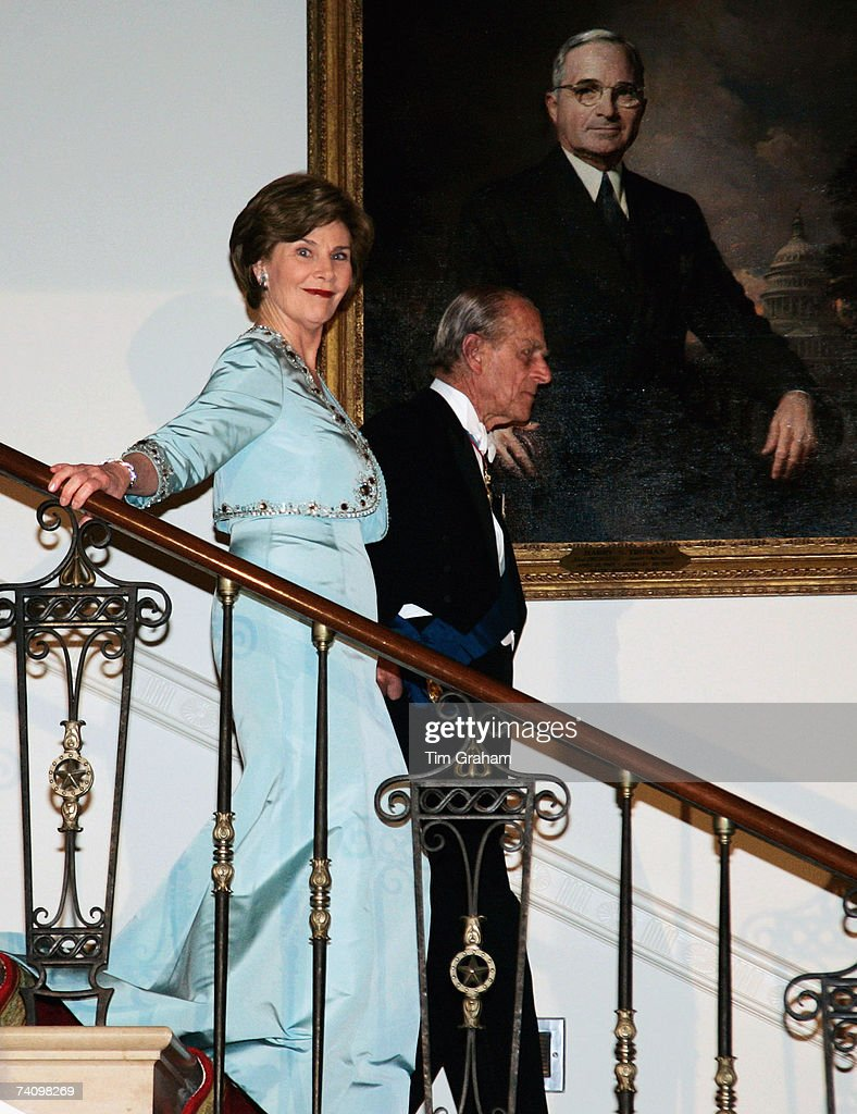 Prince Philip, Duke of Edinburgh is accompanied by Laura Bush at a State Dinner at the White House on the fifth day of their USA tour on May 7, 2007 in Washington, DC.