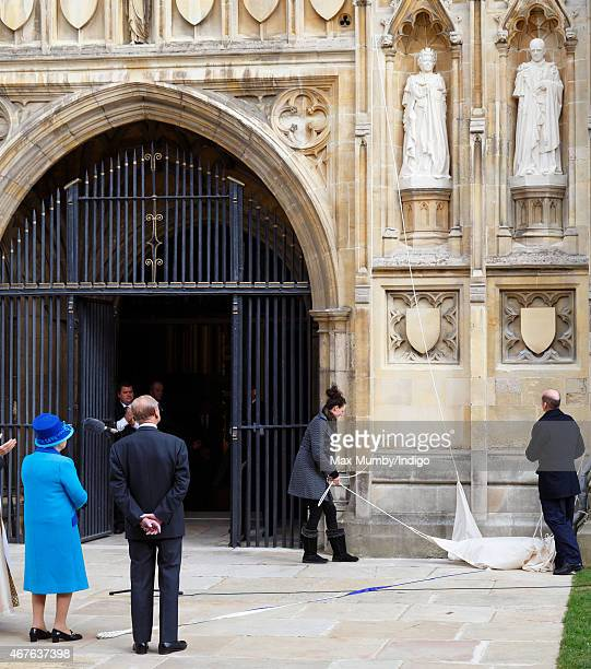 Prince Philip Duke of Edinburgh looks on as Queen Elizabeth II unveils a statue of herself and one of Prince Philip Duke of Edinburgh to mark her...