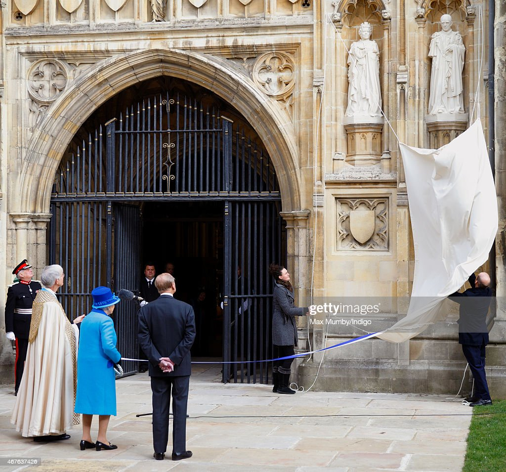 Prince Philip, Duke of Edinburgh looks on as Queen Elizabeth II unveils a statue of herself and one of Prince Philip, Duke of Edinburgh to mark her Diamond Jubilee during a visit to Canterbury Cathedral on March 26, 2015 in Canterbury, England.