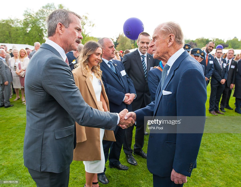 <a gi-track='captionPersonalityLinkClicked' href=/galleries/search?phrase=Prince+Philip&family=editorial&specificpeople=92394 ng-click='$event.stopPropagation()'>Prince Philip</a>, Duke of Edinburgh meets former astronaut <a gi-track='captionPersonalityLinkClicked' href=/galleries/search?phrase=Chris+Hadfield&family=editorial&specificpeople=2700911 ng-click='$event.stopPropagation()'>Chris Hadfield</a> during the Duke of Edinburgh Award's 60th Anniversary Garden Party at Buckingham Palace on May 16, 2016 in London, United Kingdom.