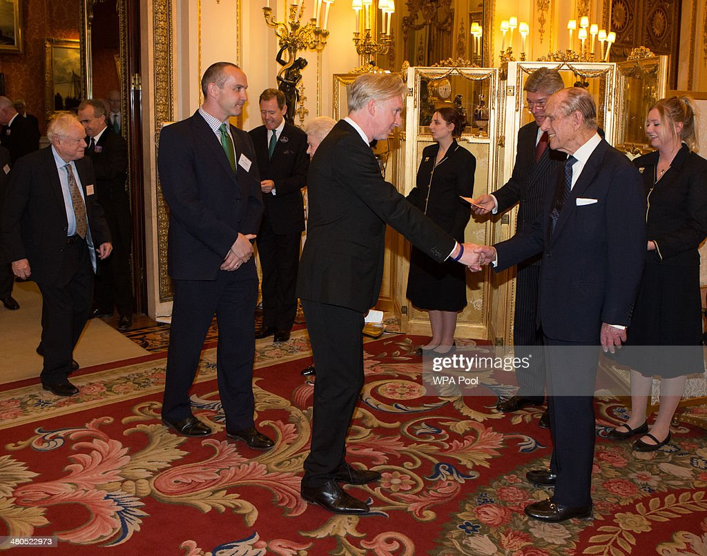 <a gi-track='captionPersonalityLinkClicked' href=/galleries/search?phrase=Prince+Philip&family=editorial&specificpeople=92394 ng-click='$event.stopPropagation()'>Prince Philip</a>, Duke of Edinburgh meets milliner <a gi-track='captionPersonalityLinkClicked' href=/galleries/search?phrase=Philip+Treacy+-+Fashion+Designer&family=editorial&specificpeople=12819932 ng-click='$event.stopPropagation()'>Philip Treacy</a> at the Irish Community Reception at Buckingham Palace on March, 25, 2014. The reception is in a advance of Ireland's President Michael D Higgins who will be the first Irish President to pay a state visit to Britain in April.
