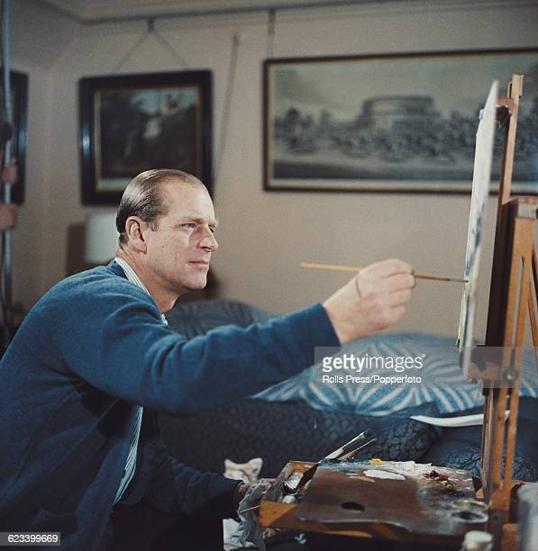 Prince Philip Duke of Edinburgh pictured painting with oil colours at an easel during filming of the television documentary 'Royal Family' in London...