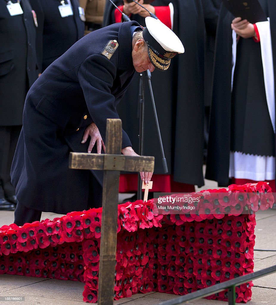Prince Philip, Duke of Edinburgh places a poppy and cross in The Field of Remembrance at Westminster Abbey on November 08, 2012 in London, England.
