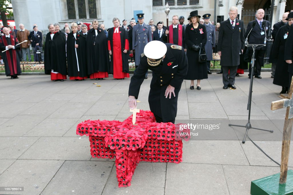 Prince Philip, Duke of Edinburgh, places a small cross as he attends the opening of the Royal British Legion's Field of Remembrance at Westminster Abbey on November 8, 2012 in London, England. Hundreds of small crosses bearing a poppy have been planted in a Field of Remembrance in a tribute to British servicemen and women who have lost their lives in conflict.