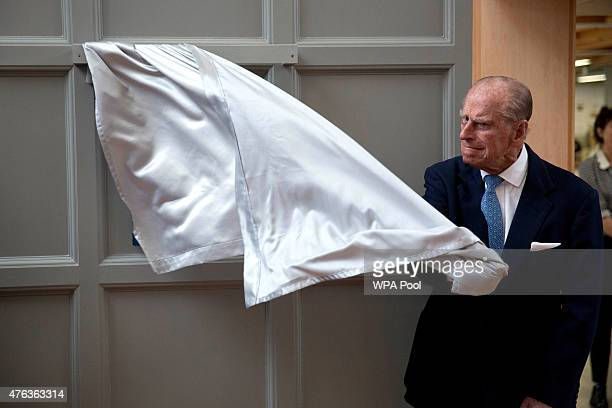 Prince Philip Duke of Edinburgh pulls the curtain to unveil a plaque at the end of his visit to Richmond Adult Community College in Richmond on June...