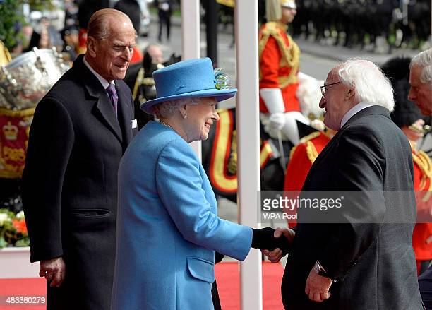 Prince Philip Duke of Edinburgh Queen Elizabeth II and President of Ireland Michael D Higgins during a ceremonial welcome at Windsor Castle on April...