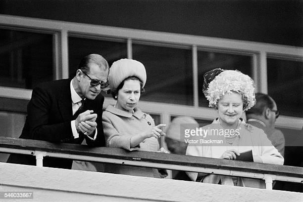 Prince Philip Duke of Edinburgh Queen Elizabeth II and Queen Elizabeth The Queen Mother watch the racing on Derby day at Epsom Downs Racecourse June...