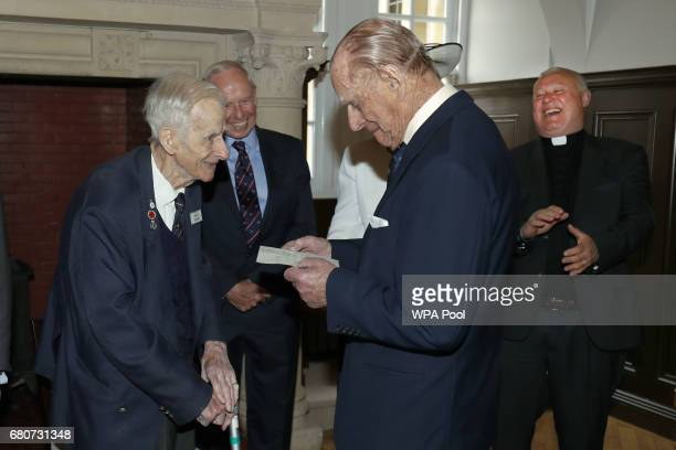 Prince Philip Duke of Edinburgh reads a letter he wrote to former naval commander Keith Evans now aged 97 after the announcement of his engagement to...
