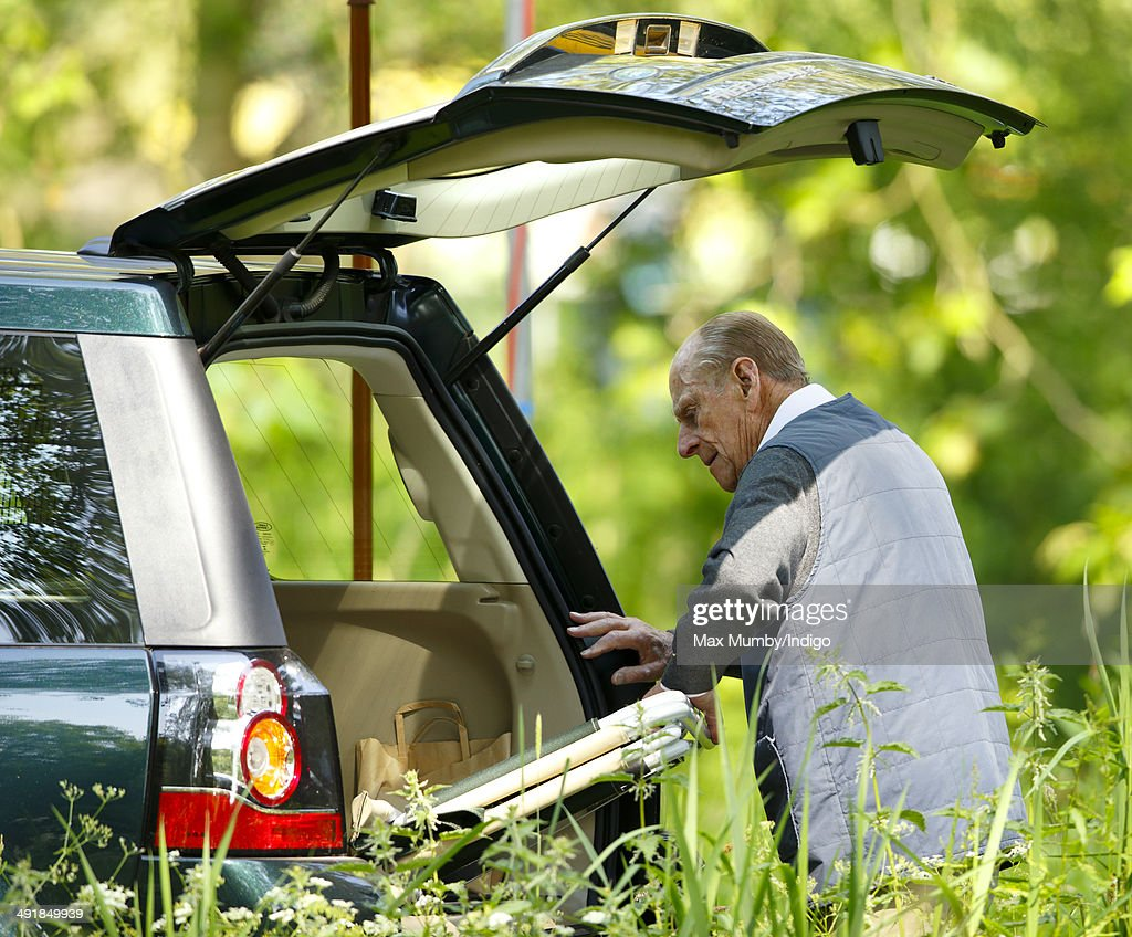 Prince Philip, Duke of Edinburgh removes a deckchair from the boot of his Land Rover Freelander car as he attends day 4 of the Royal Windsor Horse Show at Home Park on May 17, 2014 in Windsor, England.