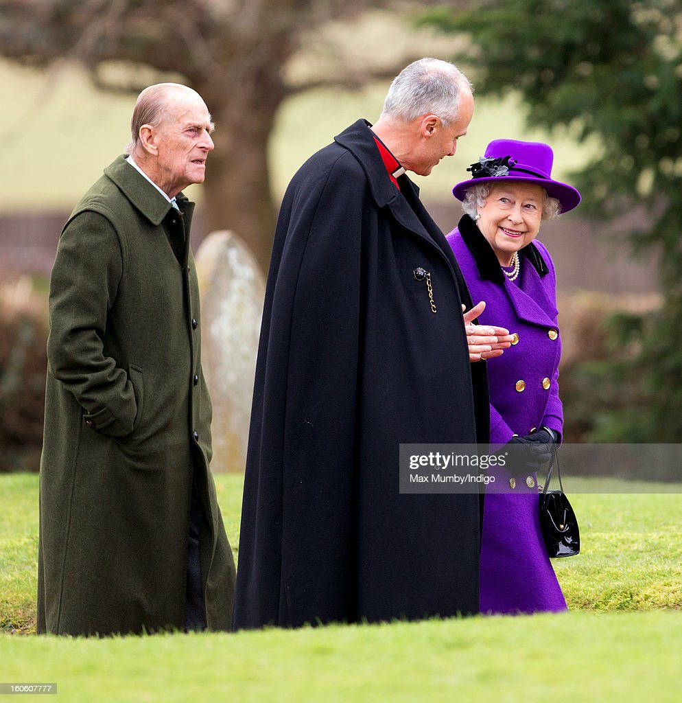 Prince Philip, Duke of Edinburgh, Reverend Jonathan Riviere and Queen <a gi-track='captionPersonalityLinkClicked' href=/galleries/search?phrase=Elizabeth+II&family=editorial&specificpeople=67226 ng-click='$event.stopPropagation()'>Elizabeth II</a> arrive at the church of St Peter and St Paul in West Newton to attend Sunday service on February 03, 2013 near King's Lynn, England.