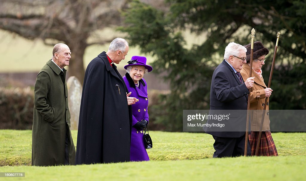 Prince Philip, Duke of Edinburgh, Reverend Jonathan Riviere and Queen Elizabeth II arrive at the church of St Peter and St Paul in West Newton to attend Sunday service on February 03, 2013 near King's Lynn, England.