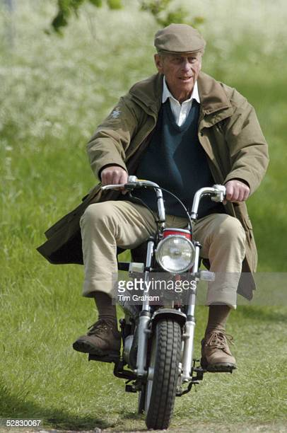 Prince Philip Duke of Edinburgh rides mini motorcycle around the Royal Windsor Horse Show on May 13 2005 in Windsor England