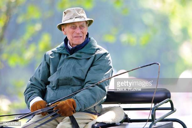 Prince Philip Duke of Edinburgh rides through the grounds of Windsor Castle during the Royal Windsor Horse Show at Home Park on May 15 2014 in...