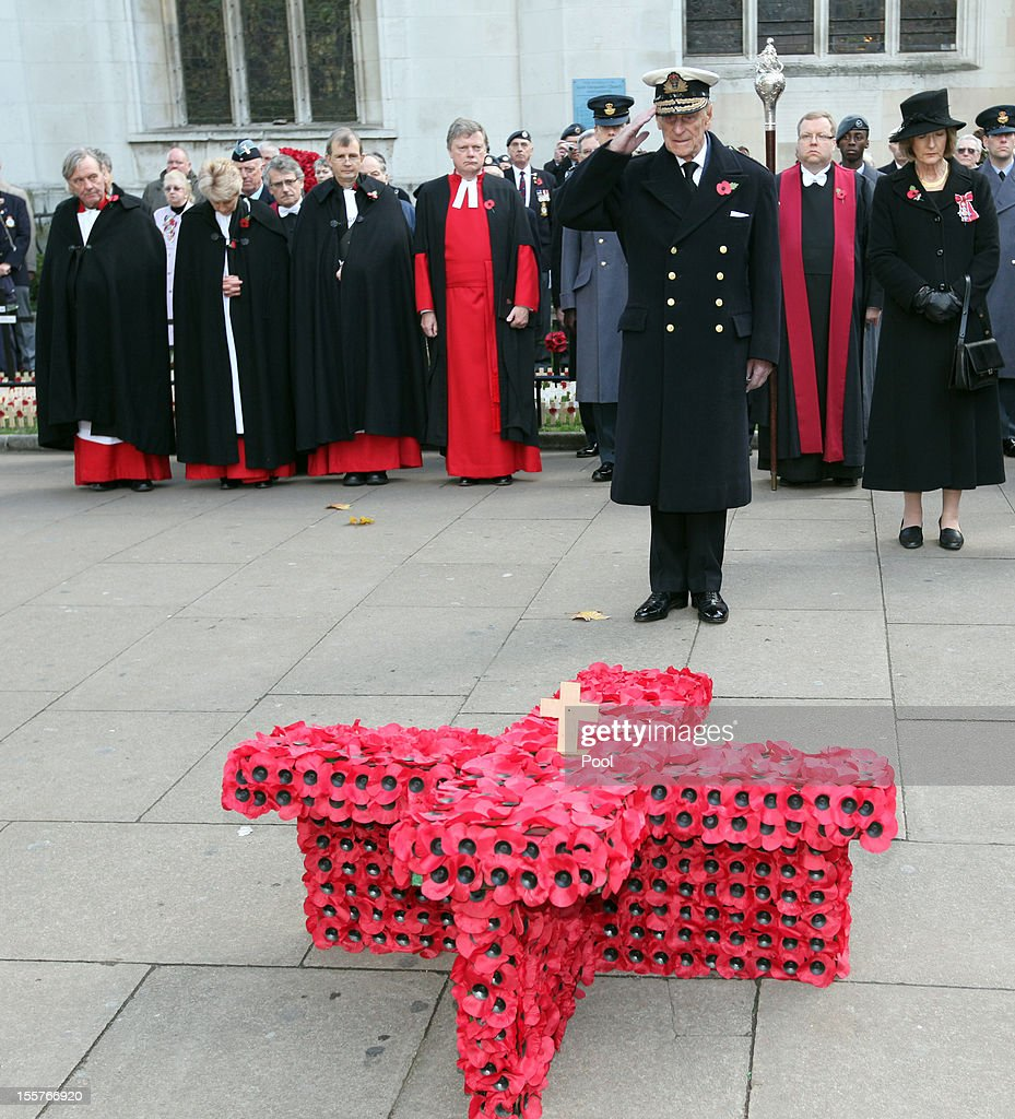 Prince Philip, Duke of Edinburgh, salutes after placing a small cross as he attends the opening of the Royal British Legion's Field of Remembrance at Westminster Abbey on November 8, 2012 in London, England. Hundreds of small crosses bearing a poppy have been planted in a Field of Remembrance in a tribute to British servicemen and women who have lost their lives in conflict.
