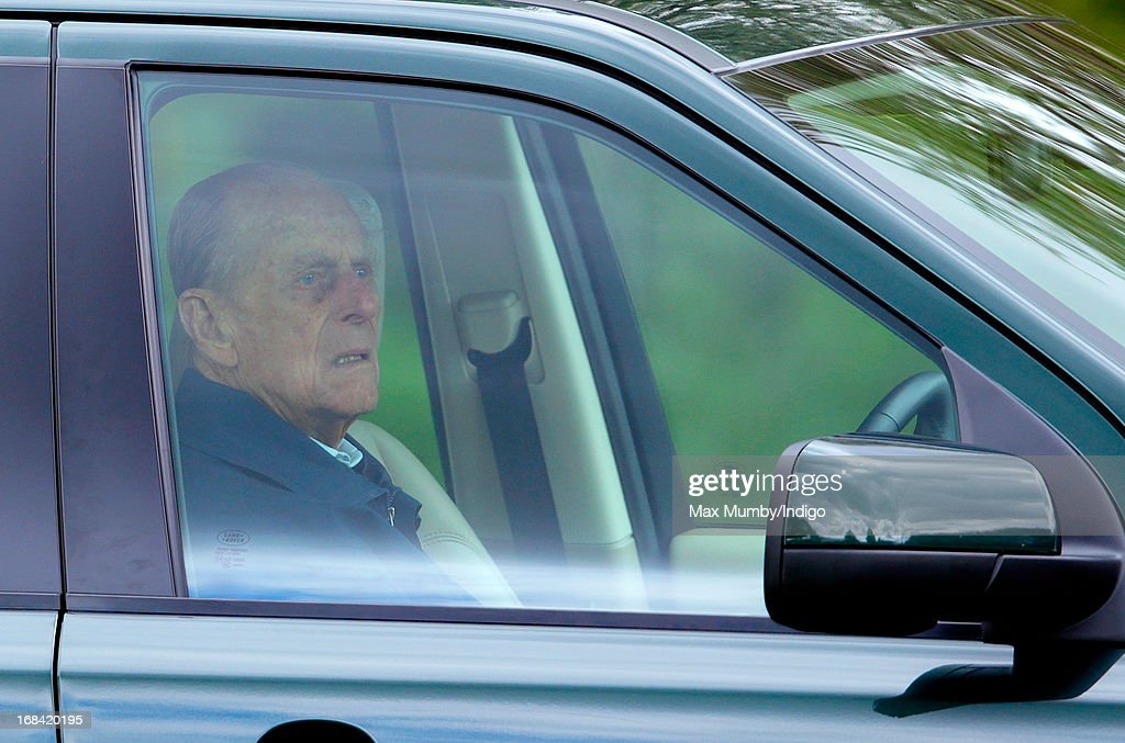 Prince Philip, Duke of Edinburgh sits in his Land Rover Freelander to watch the dressage phase of the Land Rover International Driving Grand Prix competition on day 2 of the Royal Windsor Horse Show on May 9, 2013 in Windsor, England.
