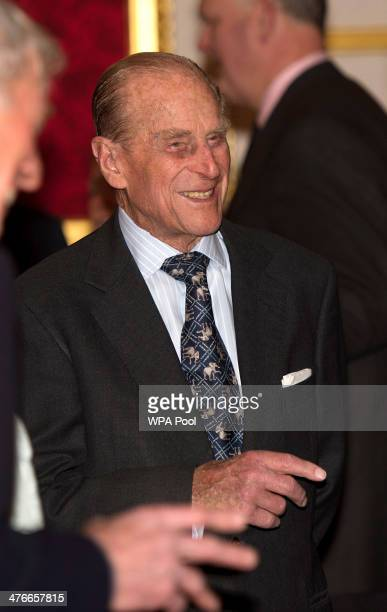 Prince Philip Duke of Edinburgh speaks to a group of guests during a reception to mark the launch of the Christ Church Cathedral Music Trust at St...