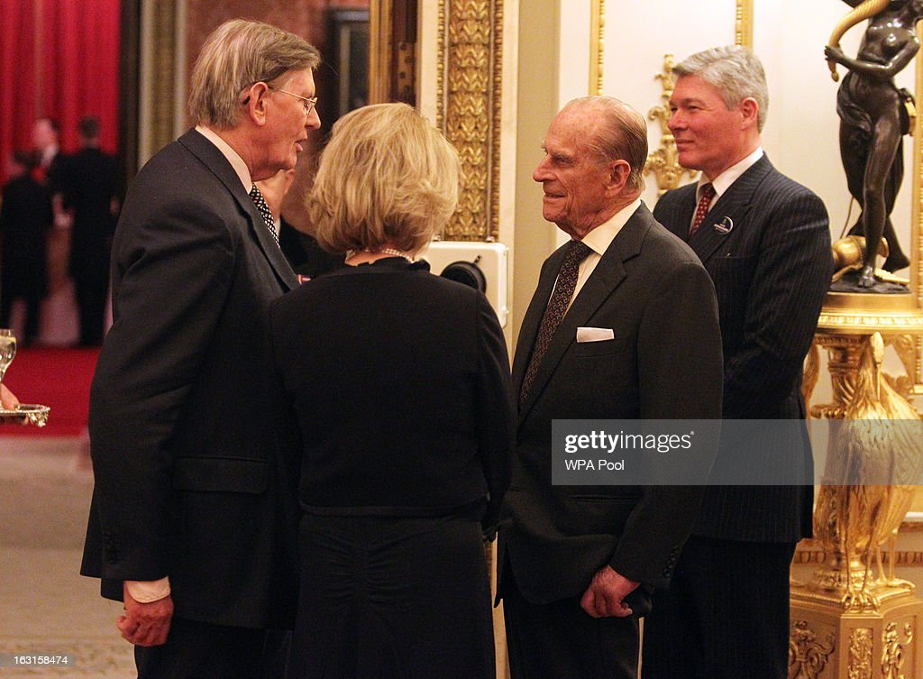Prince Philip, Duke Of Edinburgh (2nd R) speaks to Bill Cash, MP for Stone (L) during a reception for MPs and MEPs at Buckingham Palace on March 5, 2013 in London, England. The reception was attended by Prince Philip, Duke Of Edinburgh and Sophie, Countess of Wessex.