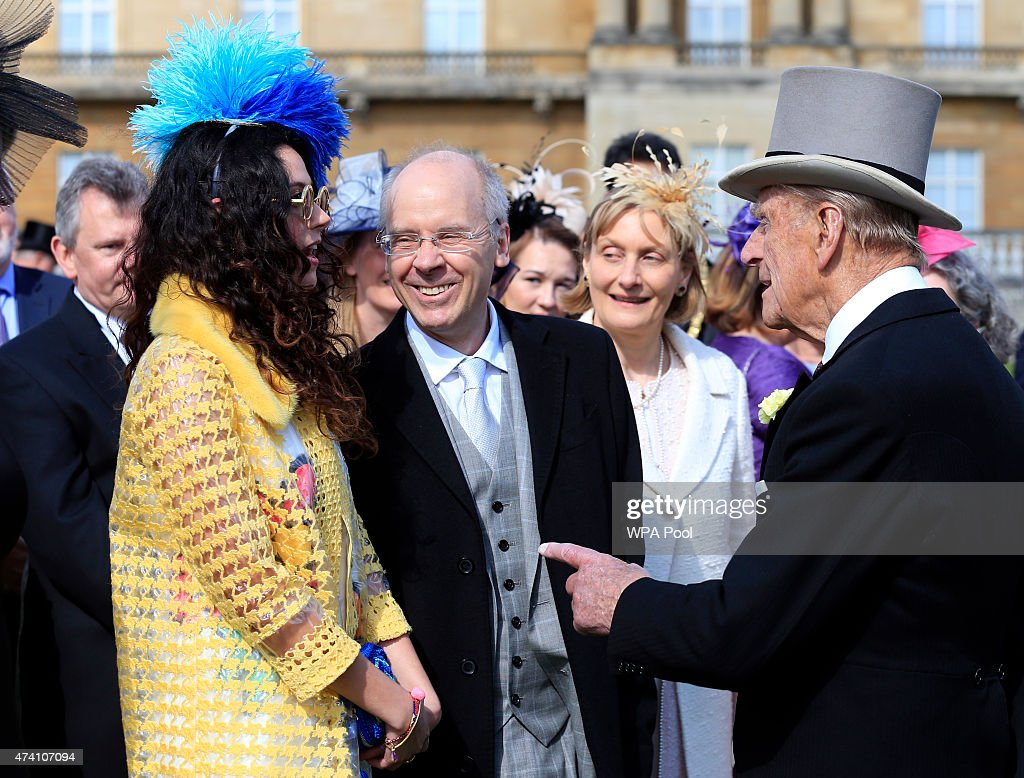 Prince Philip, Duke of Edinburgh speaks to Eliza Doolittle (L) during a garden party in the grounds of Buckingham Palace on May 20, 2015 in London, England.