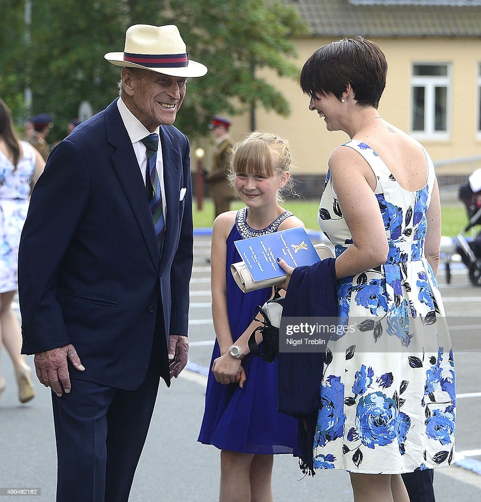 Prince Philip, Duke of Edinburgh speaks to families of soldiers of the 4th Battalion, The Royal Regiment of Scotland on June 12, 2014 in Fallingbostel, Germany.