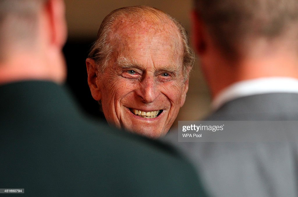 <a gi-track='captionPersonalityLinkClicked' href=/galleries/search?phrase=Prince+Philip&family=editorial&specificpeople=92394 ng-click='$event.stopPropagation()'>Prince Philip</a>, Duke of Edinburgh speaks with guests in the Great Hall as he attended a commemorative service for the Scottish National War Memorial at Edinburgh Castle on July 3, 2014 in Edinburgh, Scotland.