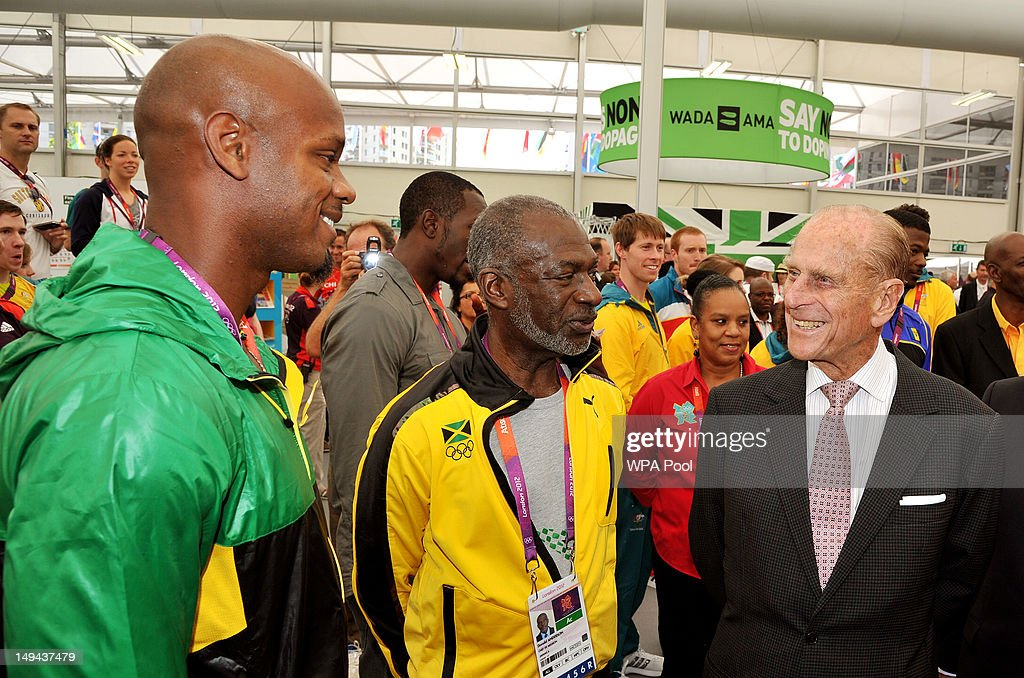 <a gi-track='captionPersonalityLinkClicked' href=/galleries/search?phrase=Prince+Philip&family=editorial&specificpeople=92394 ng-click='$event.stopPropagation()'>Prince Philip</a>, Duke of Edinburgh talks talks to Jamaican sprinter <a gi-track='captionPersonalityLinkClicked' href=/galleries/search?phrase=Asafa+Powell&family=editorial&specificpeople=240116 ng-click='$event.stopPropagation()'>Asafa Powell</a> during a tour of the Athletes Village dining hall on day one of the London 2012 Olympics Games on July 28, 2012 in London, England.