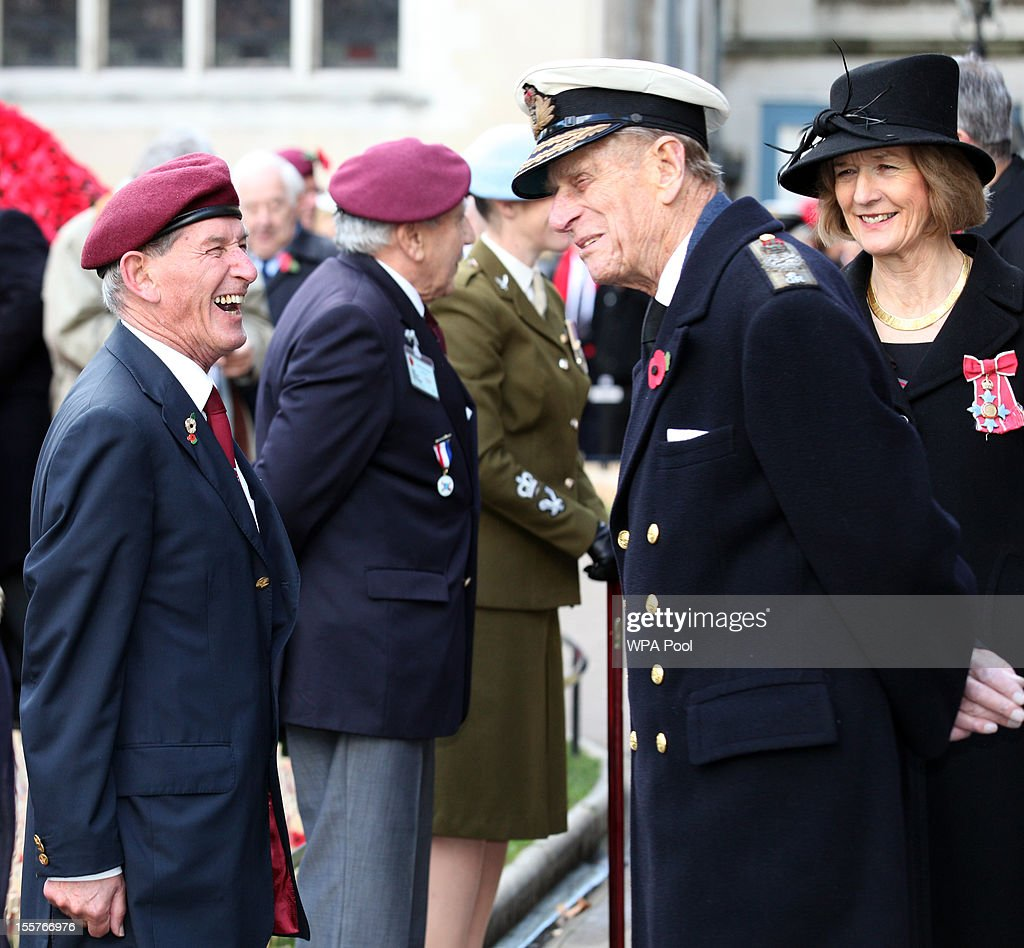 Prince Philip, Duke of Edinburgh, talks to a veteran beside Sara Jones, widow of Colonel 'H' Jones, as he attends the opening of the Royal British Legion's Field of Remembrance at Westminster Abbey on November 8, 2012 in London, England. Hundreds of small crosses bearing a poppy have been planted in a Field of Remembrance in a tribute to British servicemen and women who have lost their lives in conflict.