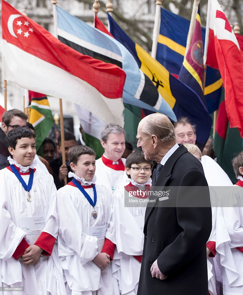 Prince Philip, Duke of Edinburgh talks to representatives from the Commonwealth countries and the choir as he leaves The Commonwealth Day Observance at Westminster Abbey on March 11, 2013 in London, England.
