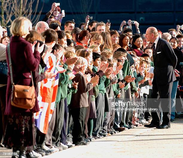 Prince Philip Duke of Edinburgh talks to school children after a tour of the newly opened Cancer Research UK Cambridge Research Institute at...